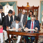 Minister for Finance Gyanendra Bahadur Karki and MCC CEO Mr. Jonathan Nash along with the Nepal Ambassador to the U.S. Dr. Arjun Kumar Karki (left) signs financial grant assistance of USD 500 million to Nepal by the US Government's Millennium Challenge Corporation (MCC) on Thursday September 14, 2017 at a Treaty Hall, Department of State, Washington D.C.