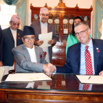 Minister for Finance Gyanendra Bahadur Karki and MCC CEO Mr. Jonathan Nash shakes hands after signing financial grant assistance of USD 500 million to Nepal by the US Government's Millennium Challenge Corporation (MCC) on Thursday September 14, 2017 at a Treaty Hall, Department of State, Washington D.C.