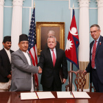 Minister for Finance Gyanendra Bahadur Karki shakes hands with the US Deputy Secretary of State Mr. John J. Sullivan along with the MCC CEO Mr. Jonathan Nash after signing financial grant assistance of USD 500 million to Nepal by the US Government's Millennium Challenge Corporation (MCC) on Thursday September 14, 2017 at a Treaty Hall, Department of State, Washington D.C.